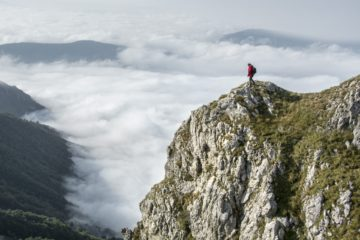 Climber standing high on a mountain to show altitude sickness