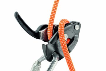 Petzl Grigri 2 Belay Device with orange climbing rope and carabiner