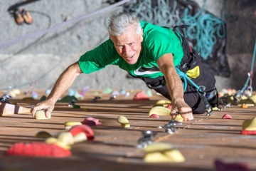 70-year-old mad climbing a bouldering wall wondering if he is too old to start bouldering